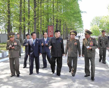 "North Korean leader Kim Jong-un (C) visits the ""February 20 factory of the Korean People's Army"" in this photo released by North Korea's Cen"