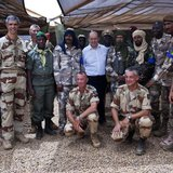 French Defence Minister Jean-Yves Le Drian (C) poses for a picture with French and Malian army officers at the French military base at the a