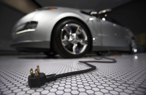 A plug is seen coming from the Chevrolet Volt electric car during the North American International Auto Show in Detroit, Michigan January 13