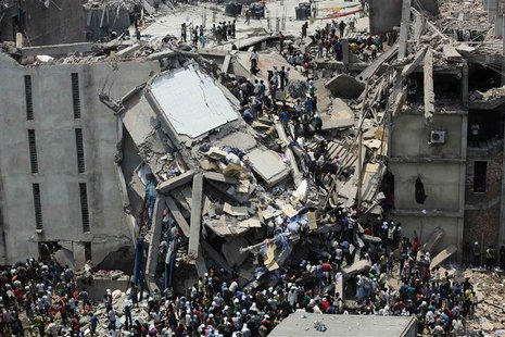 People rescue garment workers trapped under rubble at the Rana Plaza building after it collapsed, in Savar, 30 km (19 miles) outside Dhaka,