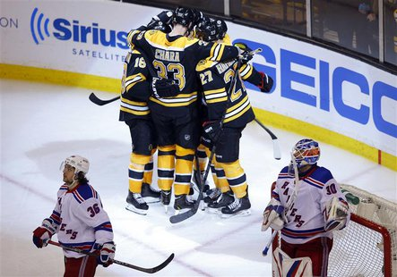 Boston Bruins' players celebrate after scoring against New York Rangers goaltender Henrik Lundqvist (R) and Rangers right wing Mats Zuccarel
