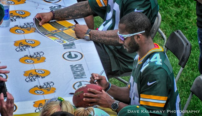 Jarrett Bush in total autograph mode!