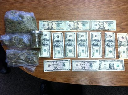 Drugs and cash seized from van during weekend traffic stop.
