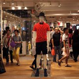 Shoppers walk inside flagship store of Japanese fashion house Uniqlo at Hong Kong's Causeway Bay shopping district May 9, 2013. REUTERS/Bobb