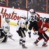 Ottawa Senators' Colin Greening (R) celebrates after scoring the game winning goal on Pittsburgh Penguins goalie Tomas Vokoun (L) during the