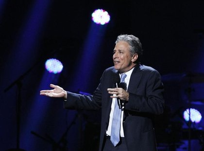 "Comedian Jon Stewart speaks during the ""12-12-12"" benefit concert for victims of Superstorm Sandy at Madison Square Garden in New York Decem"