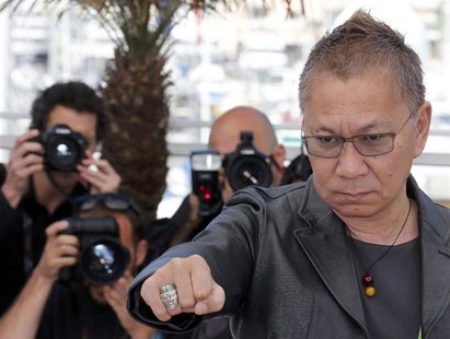 "Director Takashi Miike poses during a photocall for the film ""Wara No Tate"" (Shield of Straw) at the 66th Cannes Film Festival in Cannes May"