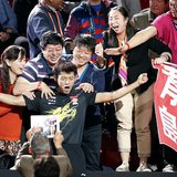 China's Zhang Jike (C) reacts among family members after defeating his compatriot Wang Hao in the men's singles final at the World Team Tabl