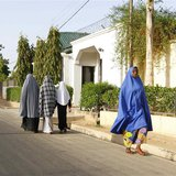 Women walk in a street in a residential area in Maiduguri, Borno State May 19, 2013, an area where President Goodluck Jonathan has declared