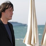 "Actor and director Keanu Reeves poses during a photocall on a front pier to present his film ""Man of Tai Chi"" at the 66th Cannes Film Festiv"