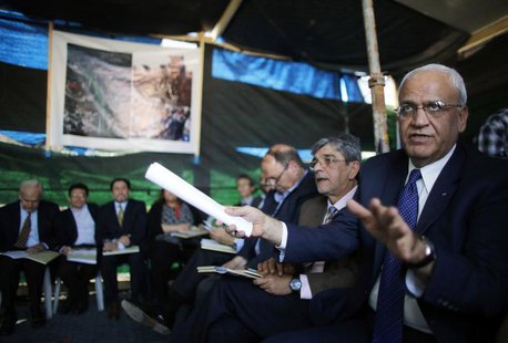 Saeb Erekat (R), a Palestinian senior politician and chief negotiator speaks during a visit to a tent set-up in protest against the construc