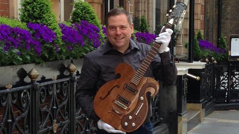 Image courtesy of Darren Julien with guitar; Facebook.com/JuliensAuctions (via ABC News Radio)