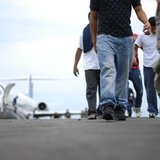 Illegal immigrants from El Salvador arrive at the Comalapa international airport after being deported from the U.S. in Comalapa, on the outs