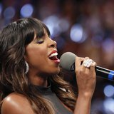 Kelly Rowland sings the U.S. national anthem before the fight between Floyd Mayweather Jr. and Robert Guererro for Mayweather Jr.'s WBC welt