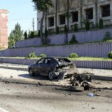 Police and investigators work at the scene of a blast in Makhachkala May 20, 2013. REUTERS/Abdula Magomedov/NewsTeam