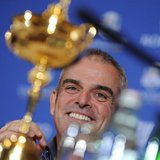 Paul McGinley of Ireland smiles near the Ryder Cup during a news conference after being named the European Ryder Cup captain at the St. Regi