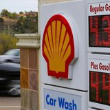Gasoline prices are displayed on a signboard at a Shell gas station in Encinitas, California, February 19, 2013. REUTERS/Mike Blake