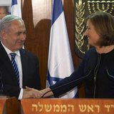 Israel's Prime Minister Benjamin Netanyahu (L) shakes hands with former Foreign Minister Tzipi Livni, head of the centrist Hatenuah party, d