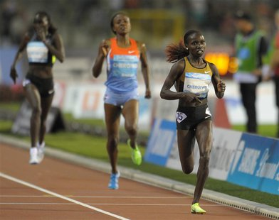 Vivian Cheruiyot of Kenya (R) competes in the women's 5000m event at the IAAF Diamond League athletics meeting, also known as Memorial Van D