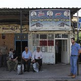 People wait for buses at the al-Abassin bus station, near Damascus' Jobar neighbourhood which is controlled by the Islamist Syrian rebel gro