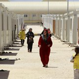 Syrian refugees walk inside the Mrajeeb Al Fhood refugee camp, 20 km (12.4 miles) east of the city of Zarqa April 29, 2013. REUTERS/Muhammad