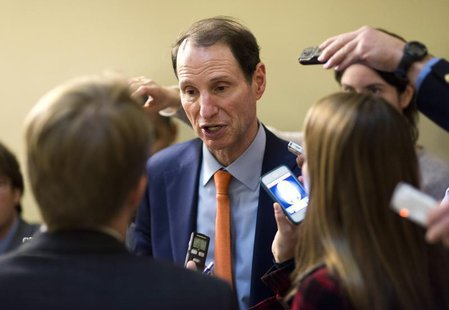 Senator Ron Wyden (D-OR) speaks to the media after the Democratic policy luncheon on Capitol Hill in Washington on December 18, 2012. REUTER