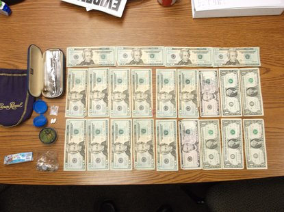 Cash, drugs, and liquor were seized in the traffic stop.