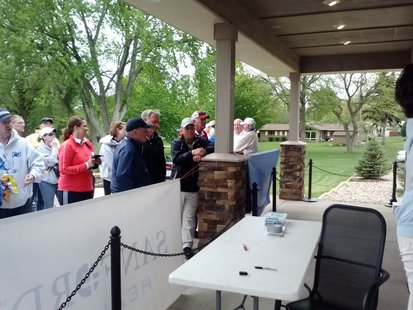 Coaches and parents gather to see the scores posted at the South Dakota State Girls Golf Championship.  (Photo by KELO/KELQ)