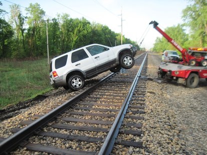 The vehicle had to be removed after becoming stuck on the railroad tracks.