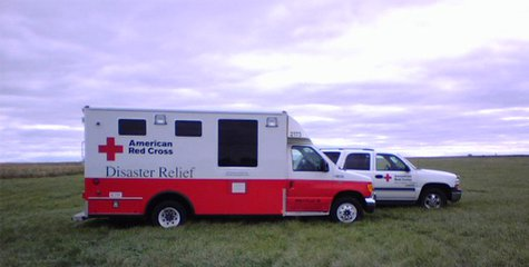Red Cross vehicles from Sioux Falls stand by to assist in any disaster situation.  (Photo Sam Hill)