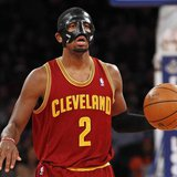 Cleveland Cavaliers point guard Kyrie Irving brings the ball up court against the New York Knicks in the second quarter of their NBA basketb