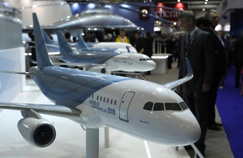A visitor looks at replica aircrafts on the Airbus booth during the Annual European Business Aviation Convention & Exhibition (EBACE) at Coi