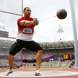 Japan's Koji Murofushi competes during Group A of the men's hammer throw qualifications in the London 2012 Olympic Games at the Olympic Stad
