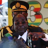 Zimbabwe's President Robert Mugabe addresses crowds gathered for the country's 33rd independence celebrations at the National Sports stadium