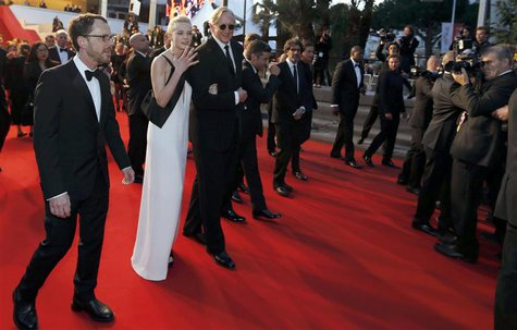 Director Ethan Coen (L), cast member Carey Mulligan (2ndL), musician T-Bone Burnett (3rdL) walk on the red carpet as they leave after the sc