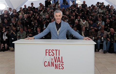Director Baz Luhrmann poses during a photocall for the film 'The Great Gatsby' before the opening of the 66th Cannes Film Festival in Cannes