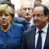Germany's Chancellor Angela Merkel and France's President Francois Hollande (R) arrive at a European Union leaders summit in Brussels May 22