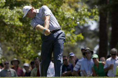 Ernie Els of South Africa hits his tee shot on the fourth hole during third round play in the 2013 Masters golf tournament at the Augusta Na