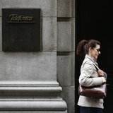 A woman walks past Telefonica's building in central Madrid March 26, 2013. REUTERS/Juan Medina