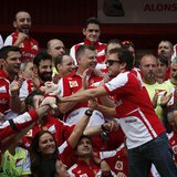Ferrari Formula One driver Fernando Alonso of Spain (R) celebrates with his team after the Spanish F1 Grand Prix at the Circuit de Catalunya