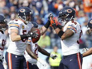Chicago Bears line backer Brian Urlacher (54) celebrates with defensive end Julius Peppers (90) after recovering a fumble in the first half