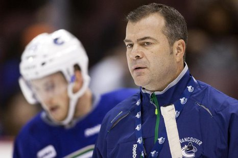 Vancouver Canucks head coach Alain Vigneault looks on during the second day of training camp in Vancouver, British Columbia January 14, 2013