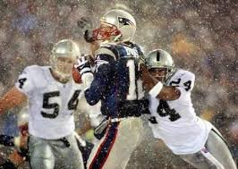 Charles Woodson sacks Tom Brady in the 2001 AFC Divisional playoff game.  The famous tuck rule was called and the Raiders went on to lose.