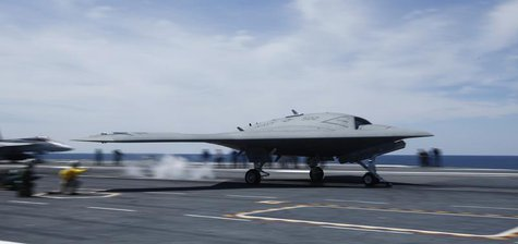 An X-47B pilot-less drone combat aircraft is launched for the first time off an aircraft carrier, the USS George H. W. Bush, in the Atlantic