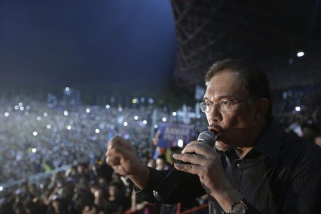 Malaysia's opposition leader Anwar Ibrahim delivers his speech during a rally in protest of the Sunday's election results at a stadium in Ke