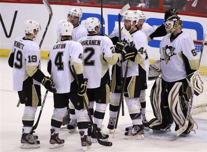 Pittsburgh Penguins goalie Tomas Vokoun (R) is congratulated by teammates after the Penguins defeated the Ottawa Senators in Game 4 of their