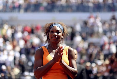 Serena Williams of the U.S. waits at the medal ceremony after winning the women's singles final match against Victoria Azarenka of Belarus a