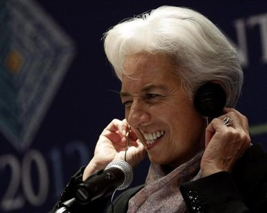 International Monetary Fund (IMF) Managing Director Christine Lagarde adjusts her headphones as she listens to a question on the second day