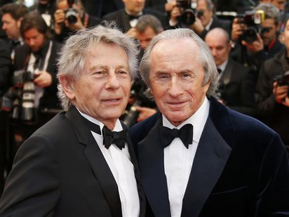 Director Roman Polanski (L) and former Formula One champion driver Jackie Stewart of Britain pose on the red carpet as they arrive for the s