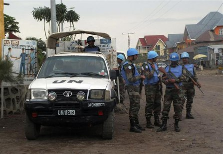U.N. peacekeepers patrol the streets during the visit of U.N. Secretary-General Ban Ki-moon and World Bank President Jim Yong Kim to Goma, i